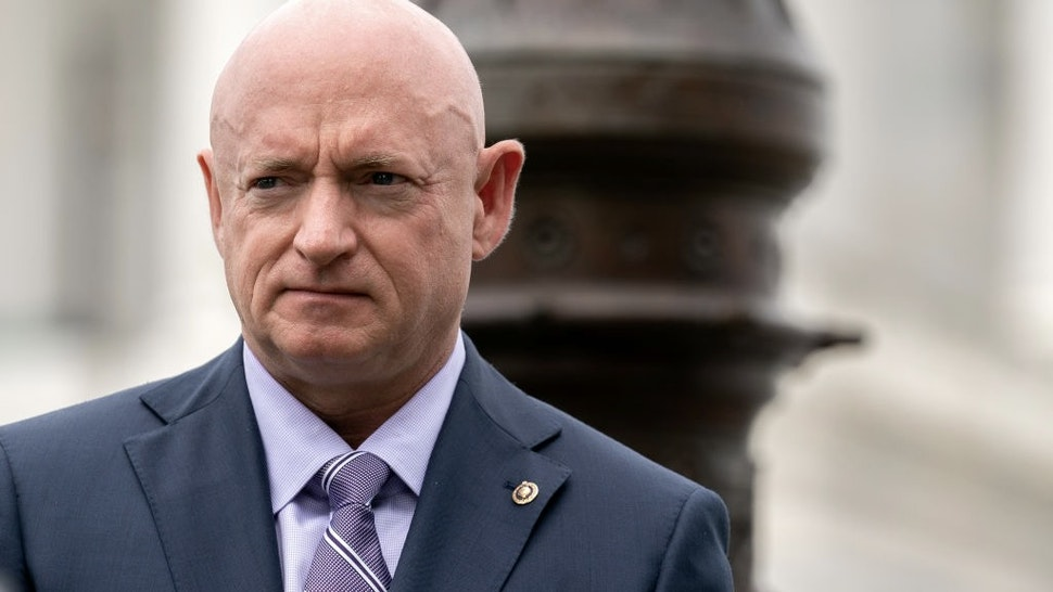 Bipartisan Members Of Senate Announce Military Justice Improvement And Increasing Prevention Act WASHINGTON, DC - APRIL 29: U.S. Sen. Mark Kelly (D-AZ) listens during a news conference outside the U.S. Capitol on April 29, 2021 in Washington, DC. A bipartisan group of Senators gathered in support of the Military Justice Improvement and Increasing Prevention Act, which would move the decision to prosecute a member of the military from the chain of command to independent, trained, professional military prosecutors. (Photo by Stefani Reynolds/Getty Images)