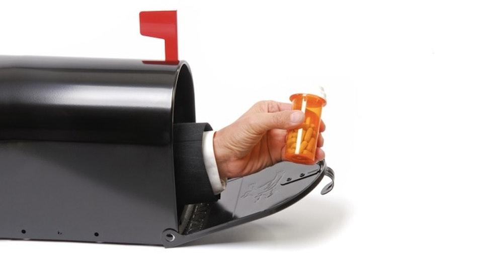 Mailbox Prescription - stock photo Mailbox with business man holding prescription bottle.