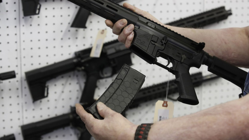 A salesperson holds a high capacity magazine for an AR-15 rifle at a store in Orem, Utah, U.S., on Thursday, March 25, 2021. Two mass shootings in one week are giving Democrats new urgency to pass gun control legislation, but opposition from Republicans in the Senate remains the biggest obstacle to any breakthrough in the long-stalled debate. Photographer: George Frey/Bloomberg