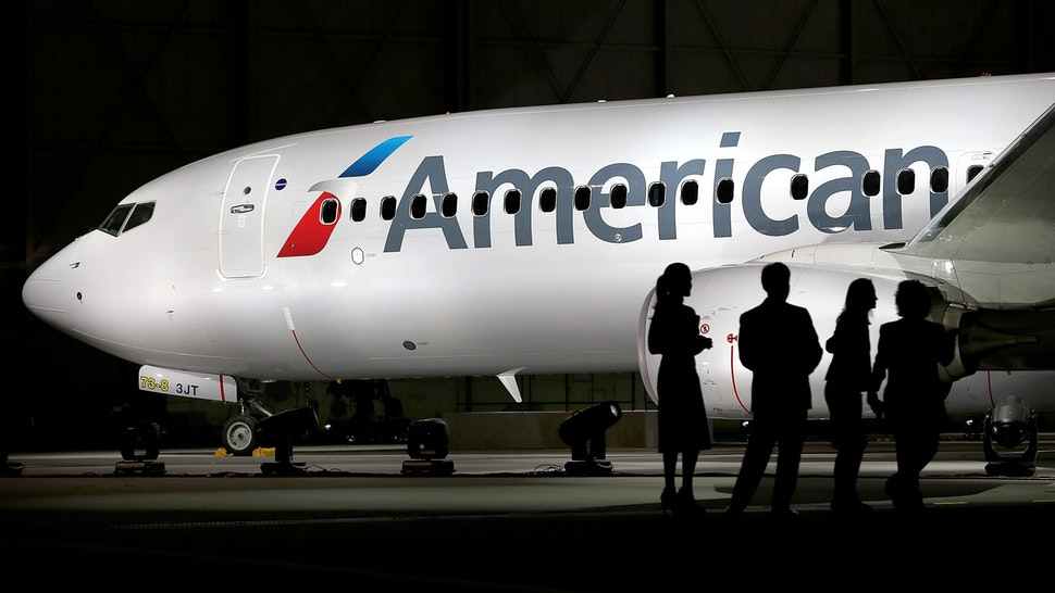 DALLAS, TX - JANUARY 17: American Airlines unveils a new company logo and exterior paint scheme on a Boeing 737-800 aircraft on January 17, 2013 in Dallas, Texas. The exterior changes are the first for the company since 1968 and were announced as the parent company of American Airlines, AMR, is considering a merger with US Airways.