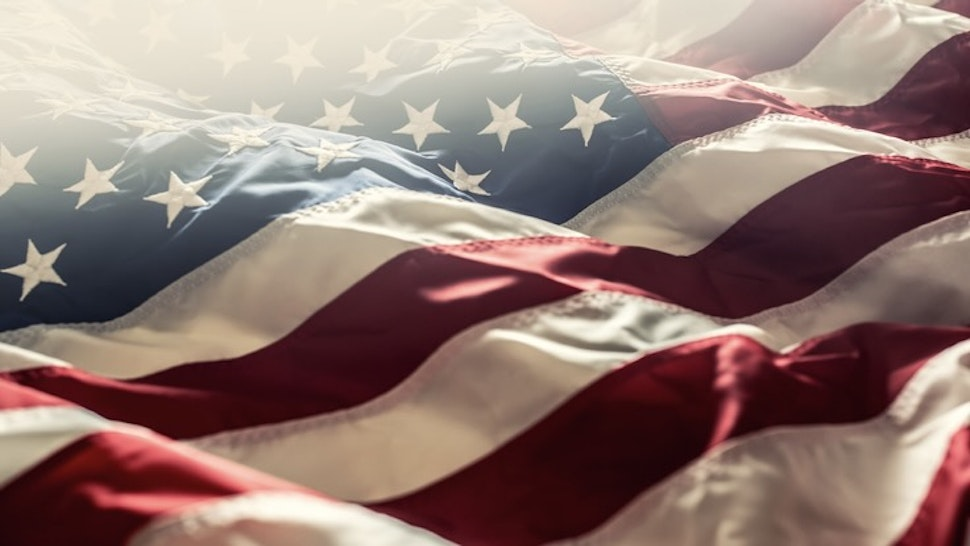 American flag waving in the wind - American symbol of 4th of july independence day democracy and patriotism. - stock photo American flag waving in the wind - American symbol of 4th of july independence day democracy and patriotism.