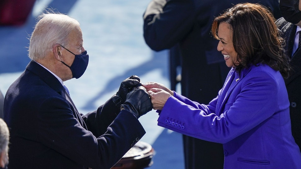 WASHINGTON, DC - JANUARY 20: U.S. President-elect Joe Biden fist bumps newly sworn-in Vice President Kamala Harris after she took the oath of office on the West Front of the U.S. Capitol on January 20, 2021 in Washington, DC. Biden was sworn in today as the 46th president of the United States.