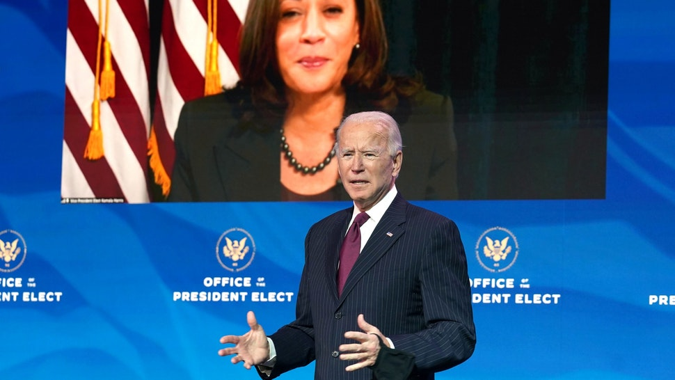 WILMINGTON, DELAWARE - DECEMBER 16: Vice President-elect Kamala Harris, appearing via video link, listens as U.S. President-elect Joe Biden speaks during a news conference at his transition headquarters on December 16, 2020 in Wilmington, Delaware. Biden made further announcements regarding his administration's cabinet choices including nominating former Democratic presidential candidate Pete Buttigieg to be Transportation Secretary.