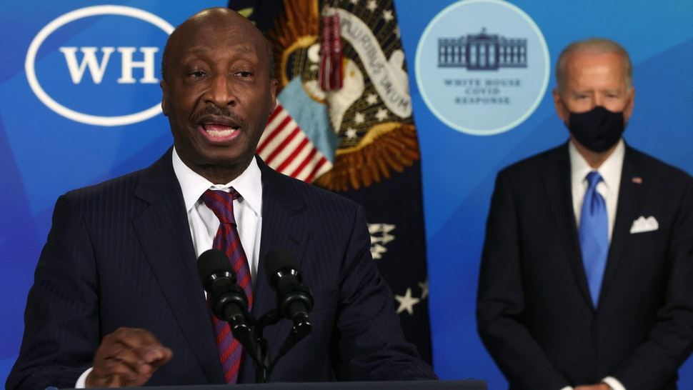 WASHINGTON, DC - MARCH 10: U.S. President Joe Biden (R) listens as Chairman and CEO of Merck & Co. Kenneth Frazier (L) speaks during an event at the South Court Auditorium of the Eisenhower Executive Office Building March 10, 2021 in Washington, DC. President Biden announced that the government will purchase 100 million more doses of the Johnson & Johnson COVID-19 vaccine.