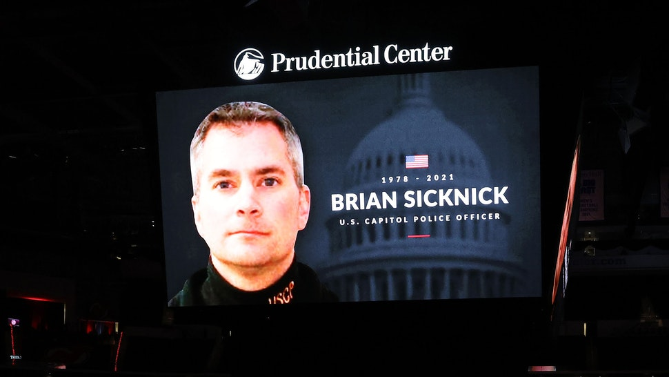 NEWARK, NEW JERSEY - JANUARY 14: The New Jersey Devils honor slain Capitol police officer and New Jersey native Brian Sicknick before the game between the New Jersey Devils and the Boston Bruins during the home opening game at Prudential Center on January 14, 2021 in Newark, New Jersey.