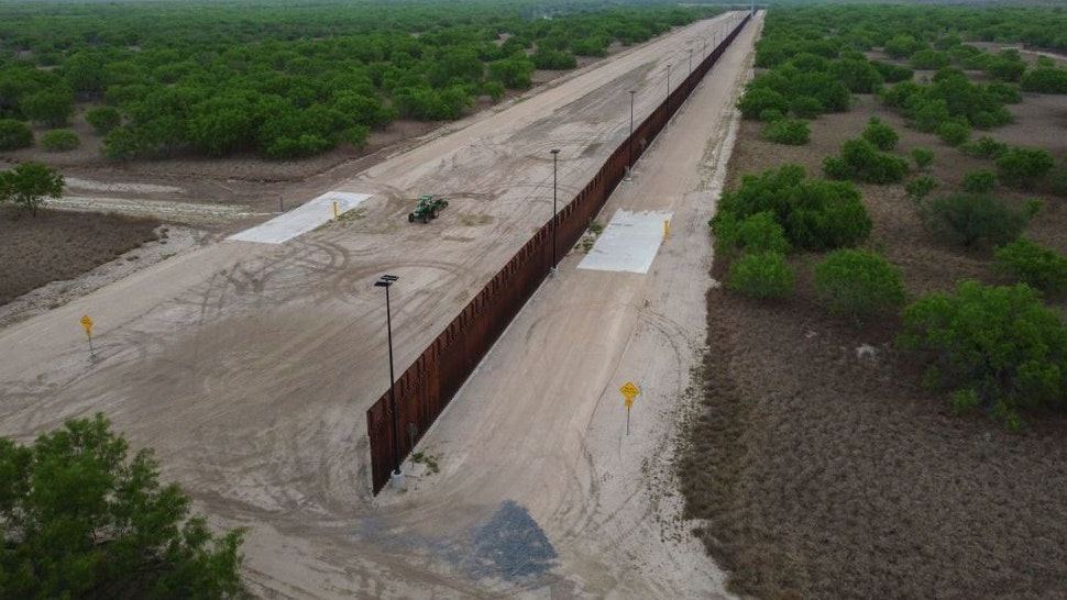 A photo taken on March 30, 2021 shows a general view of an unfinished section of a border wall that former US president Donald Trump tried to build near the southern Texas border city of Roma. - The 11,000 inhabitants of the Texas border town Roma have been living with illegal immigrants for decades. Many have mixed feelings about the new arrivals: empathy and compassion on the one hand - especially since many of their family members also arrived in the United States illegally - but also concern and fear about the growing number of migrants in recent months. Sometimes 500 per night, many of them families or unaccompanied minors. (Photo by Ed JONES / AFP) (Photo by ED JONES/AFP via Getty Images)