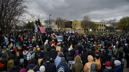 BROOKLYN CENTER, MN - APRIL 13: Protesters gather outside the Brooklyn Center police headquarters on April 13, 2021 in Brooklyn Center, Minnesota. Demonstrations have become a daily occurrence since Daunte Wright, 20, was shot and killed by Brooklyn Center police officer Kimberly Potter on Sunday.