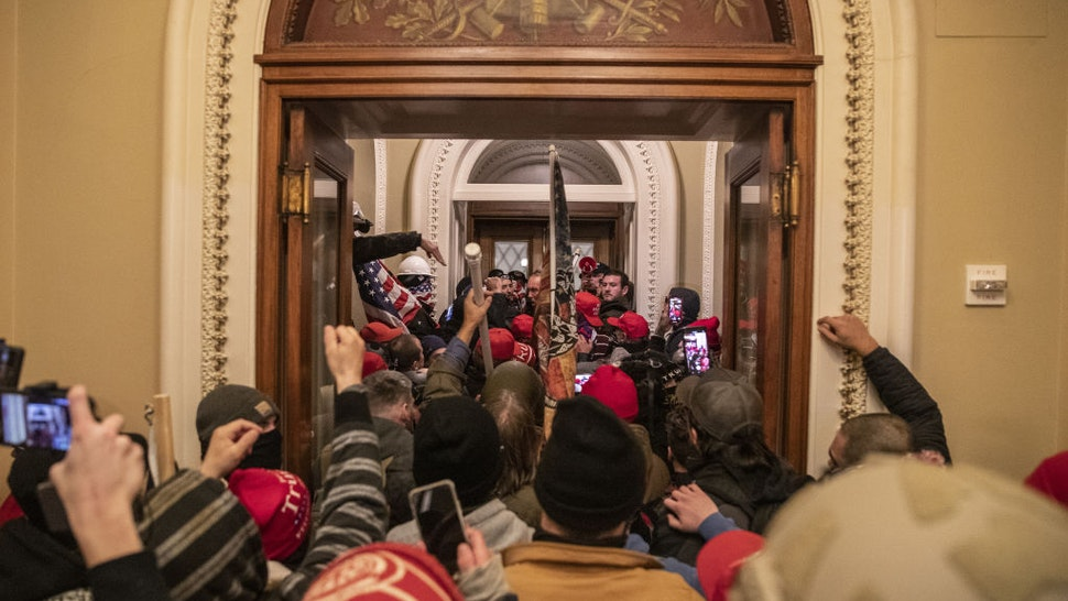 Demonstrators walk through the U.S. Capitol after breaching barricades to the building during a protest outside of in Washington, D.C., U.S., on Wednesday, Jan. 6, 2021. The U.S. Capitol was placed under lockdown and Vice President Mike Pence left the floor of Congress as hundreds of protesters swarmed past barricades surrounding the building where lawmakers were debating Joe Biden's victory in the Electoral College.