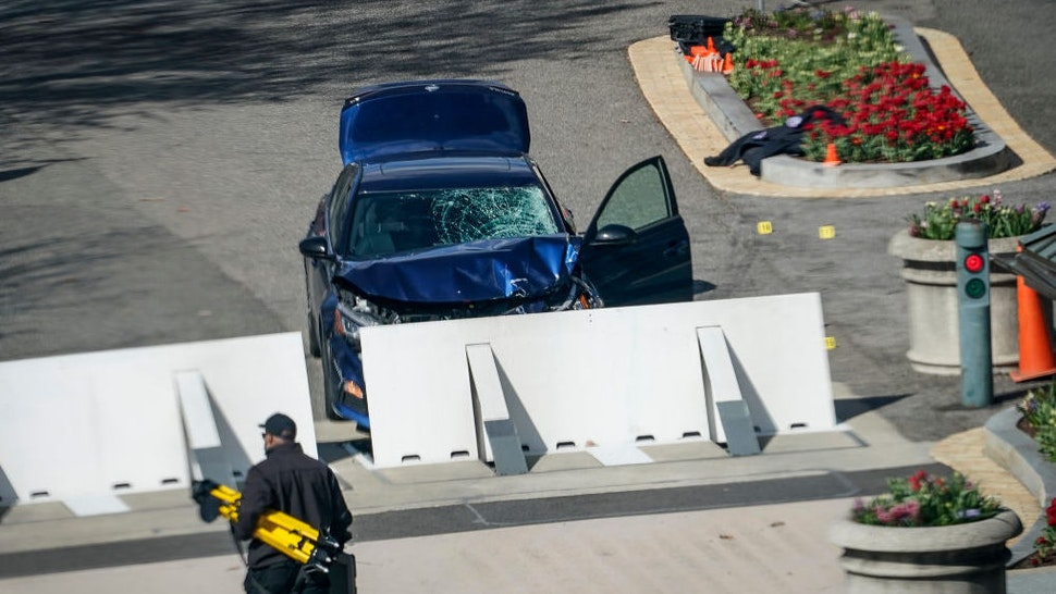 WASHINGTON, DC - APRIL 02: Law enforcement investigate the scene after a vehicle charged a barricade at the U.S. Capitol on April 02, 2021 in Washington, DC. The U.S. Capitol was briefly locked down after a person reportedly rammed a vehicle into multiple Capitol Hill police officers. One officer was killed and one was wounded. The suspect who exited the vehicle with a knife was fatally shot.