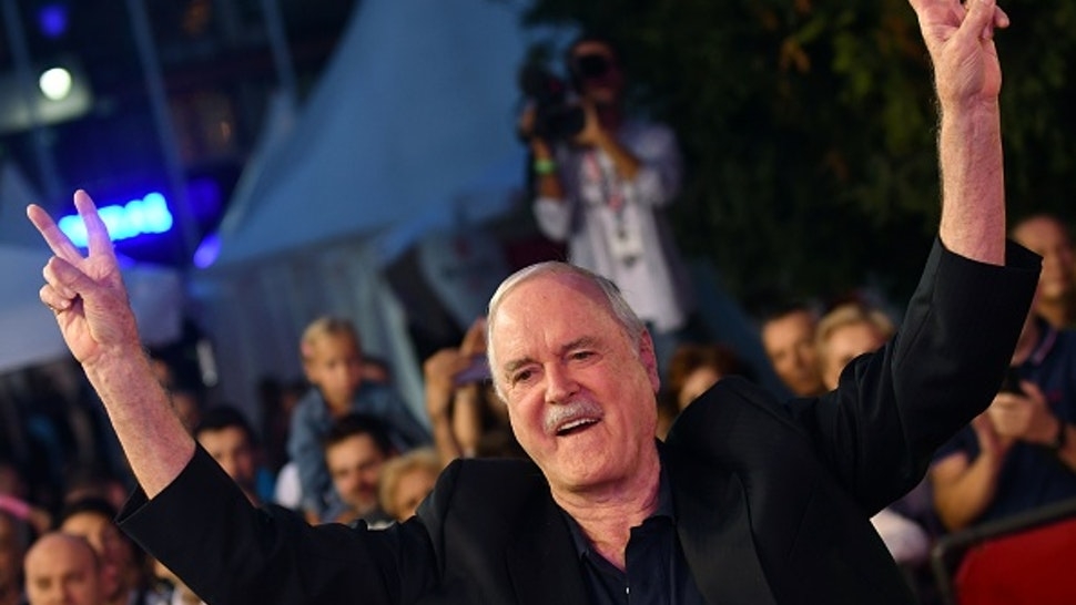 """British actor John Cleese arrives for the 23rd Sarajevo Film Festival late on August 16, 2017, where he is to receive the 'Honorary Heart Of Sarajevo' award for his """"extraordinary contribution"""" to film. / AFP PHOTO / ELVIS BARUKCIC"""