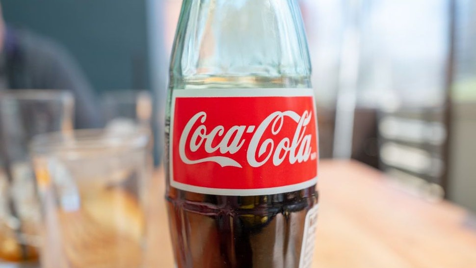 Close-up of logo for Coca Cola on glass bottle in a restaurant setting, Walnut Creek, California, March 4, 2021. (Photo by Smith Collection/Gado/Getty Images)