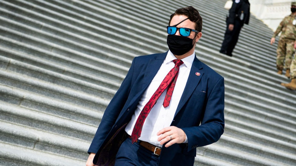 """UNITED STATES - FEBRUARY 26: Rep. Dan Crenshaw, R-Texas, is seen outside the Capitol during a vote on the """"Protecting America's Wilderness and Public Lands Act,"""" on Friday, February 26, 2021."""