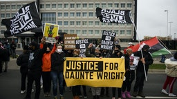 BROOKLYN CENTER, MN - APRIL 13: Protesters march from the Brooklyn Center police headquarters to a nearby FBI office on April 13, 2021 in Brooklyn Center, Minnesota. Demonstrations have become a daily occurrence since Daunte Wright, 20, was shot and killed by Brooklyn Center police officer Kimberly Potter on Sunday. Photo by Stephen Maturen/Getty Images)