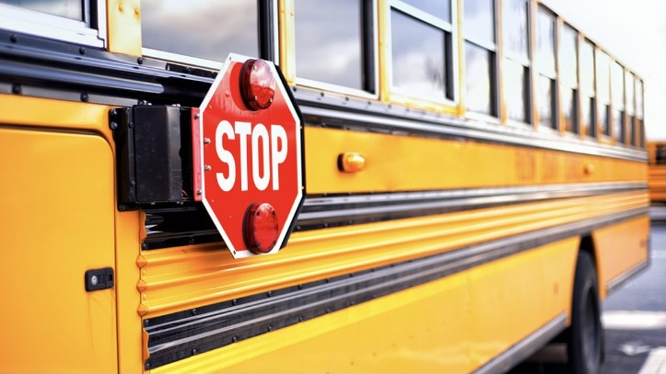 STOP - stock photo Close up of a yellow school bus with the red STOP sign