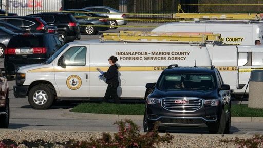 Marion County Forensic Services vehicles are parked at the site of a mass shooting at a FedEx facility in Indianapolis, Indiana on April 16, 2021. - At least eight people were killed at the facility late April 15 by a gunman, who is believed to have then turned the gun on himself, police in Indianapolis said. Four people with gunshot wounds were transported by ambulance, including one in critical condition, police said. Three were transported with other injuries, while two were treated at the scene and then released.