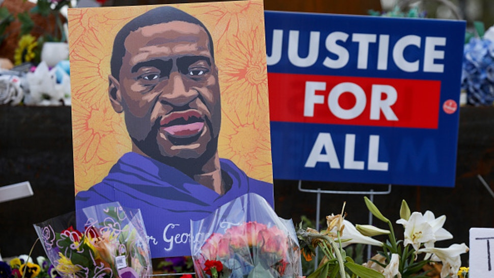 MINNEAPOLIS, MINNESOTA - APRIL 21: People lay flowers at a memorial in George Floyd Square in Minneapolis, Minnesota, United States on April 21, 2021. George Floyd by the Cup Foods where he was killed by Minneapolis Police Officer Derek Chauvin in Minneapolis, Minnesota.