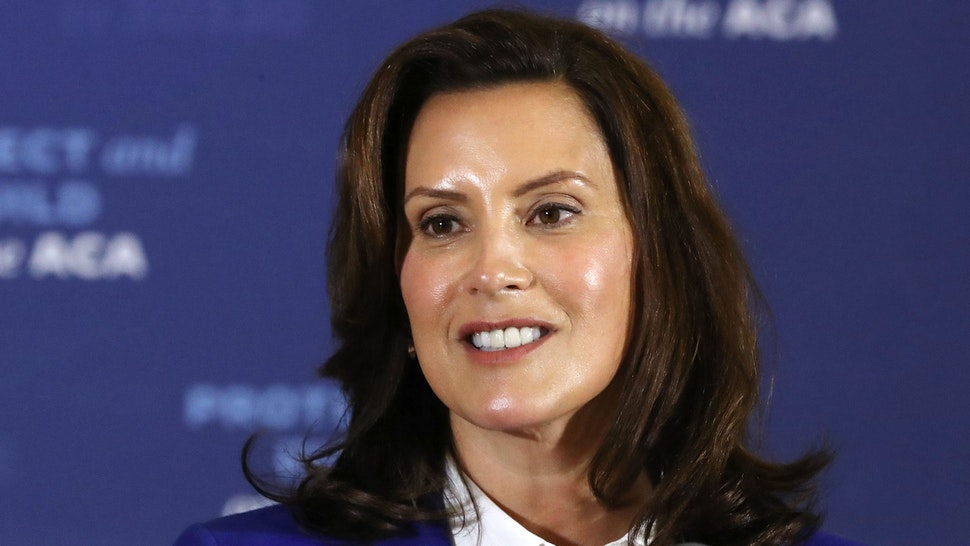 SOUTHFIELD, MICHIGAN - OCTOBER 16: Gov. Gretchen Whitmer introduces Democratic presidential nominee Joe Biden delivers remarks about health care at Beech Woods Recreation Center October 16, 2020 in Southfield,m Michigan. With 18 days until the election, Biden is campaigning in Michigan, a state President Donald Trump won in 2016 by less than 11,000 votes, the narrowest margin of victory in the state's presidential election history.