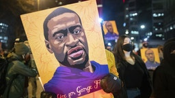 MINNEAPOLIS, MN, UNITED STATES - APRIL 9: Protesters, demanding justice for George Floyd, gather in front of the Hennepin County Government Center, where the trial of former Minneapolis police officer Derek Chauvin has been ongoing, to stage a protest and march through the streets of downtown Minneapolis, Minnesota United States on April 9, 2021. (Photo by Christopher Mark Juhn/Anadolu Agency via Getty Images)