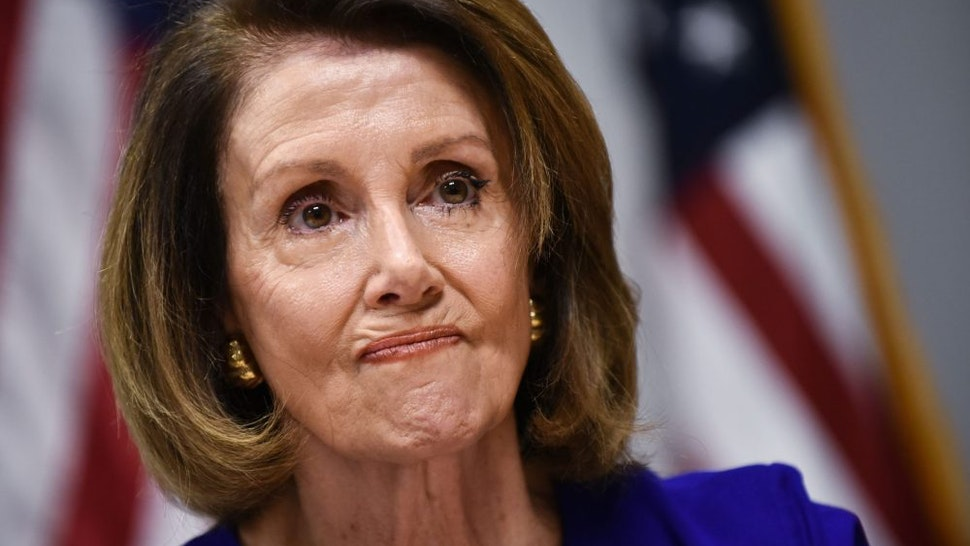 House minority leader Nancy Pelosi, D-CA, speaks during a press conference at Democratic National Committee headquarters in Washington, DC on November 6, 2018. - Americans started voting Tuesday in critical midterm elections that mark the first major voter test of US President Donald Trump's controversial presidency, with control of Congress at stake.