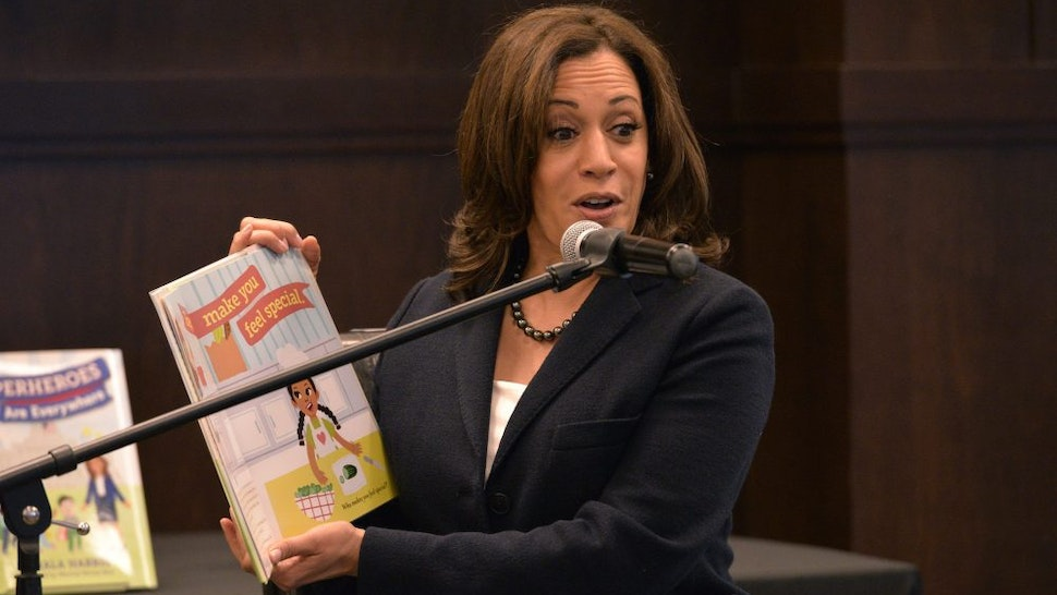 """LOS ANGELES, CALIFORNIA - JANUARY 13: California Senator Kamala Harris reads to her audience at a signing event for her childrens book """"Superheros Are Everywhere"""" at Barnes & Noble at The Grove on January 13, 2019 in Los Angeles, California."""