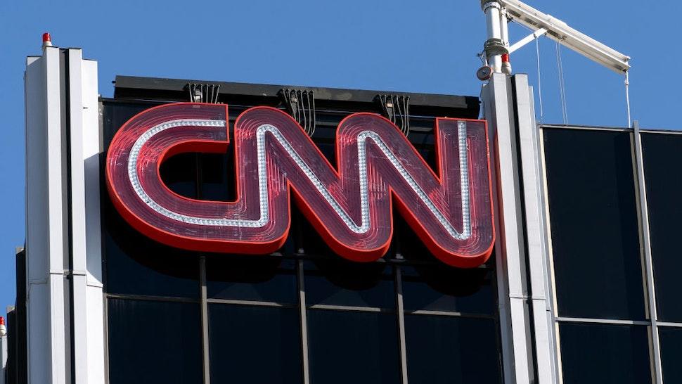 The CNN logo is seen atop its bureau in Los Angeles, California.