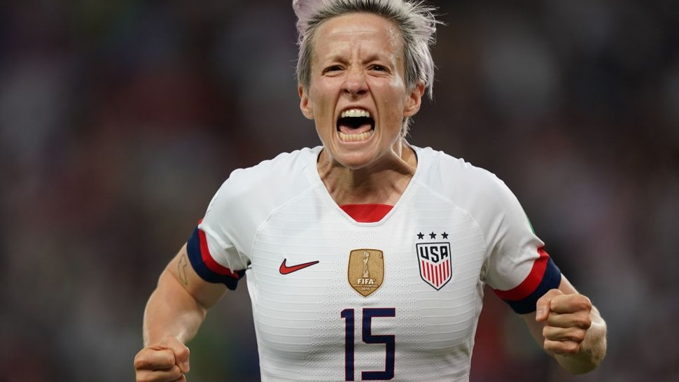 TOPSHOT - United States' forward Megan Rapinoe celebrates after scoring a goal during the France 2019 Women's World Cup quarter-final football match between France and USA, on June 28, 2019, at the Parc des Princes stadium in Paris. (Photo by Lionel BONAVENTURE / AFP) (Photo credit should read LIONEL BONAVENTURE/AFP via Getty Images)