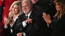 Radio personality Rush Limbaugh pumps his fist as he is acknowledged by US President Donald Trump as he delivers the State of the Union address at the US Capitol in Washington, DC, on February 4, 2020. (Photo by MANDEL NGAN / AFP) (Photo by MANDEL NGAN/AFP via Getty Images)