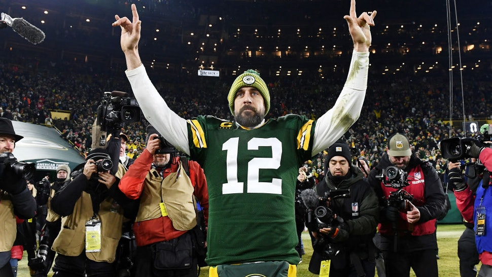 GREEN BAY, WISCONSIN - JANUARY 12: Aaron Rodgers #12 of the Green Bay Packers celebrates after defeating the Seattle Seahawks 28-23 in the NFC Divisional Playoff game at Lambeau Field on January 12, 2020 in Green Bay, Wisconsin. (Photo by Stacy Revere/Getty Images)