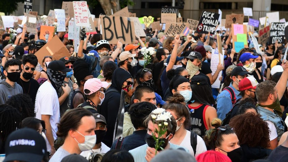 A large crowd of demonstrators rally in front of the District Attorney's office protesting the death of George Floyd, who died in police custody, on June 3, 2020 in Los Angeles.