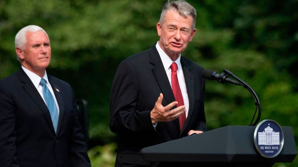 US Vice President President Mike Pence(L) listens as Idaho Governor Brad Little(R-ID) speaks at the White House in Washington, DC, on July 16, 2020, during an event on Rolling Back Regulations to Help All Americans on the South Lawn at the White House on July 16, 2020 in Washington,DC.