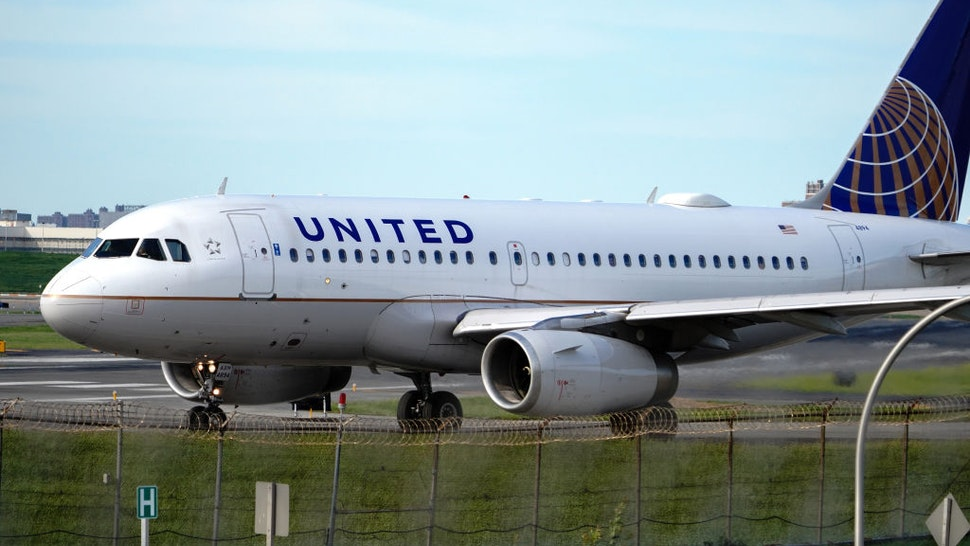 A view of a United Airlines aircraft taxiing at La Guardia Airport.
