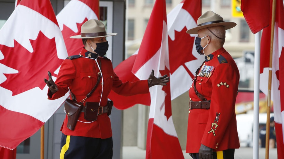Royal Canadian Mounted Police officers (RCMP) wearing protective masks stand outside the Senate of Canada before the Throne Speech in Ottawa, Ontario, Canada, on Wednesday, Sept. 23, 2020. Prime MinisterJustin Trudeausays his government will launch a campaign to create 1 million jobs in Canada, returning employment to pre-pandemic levels