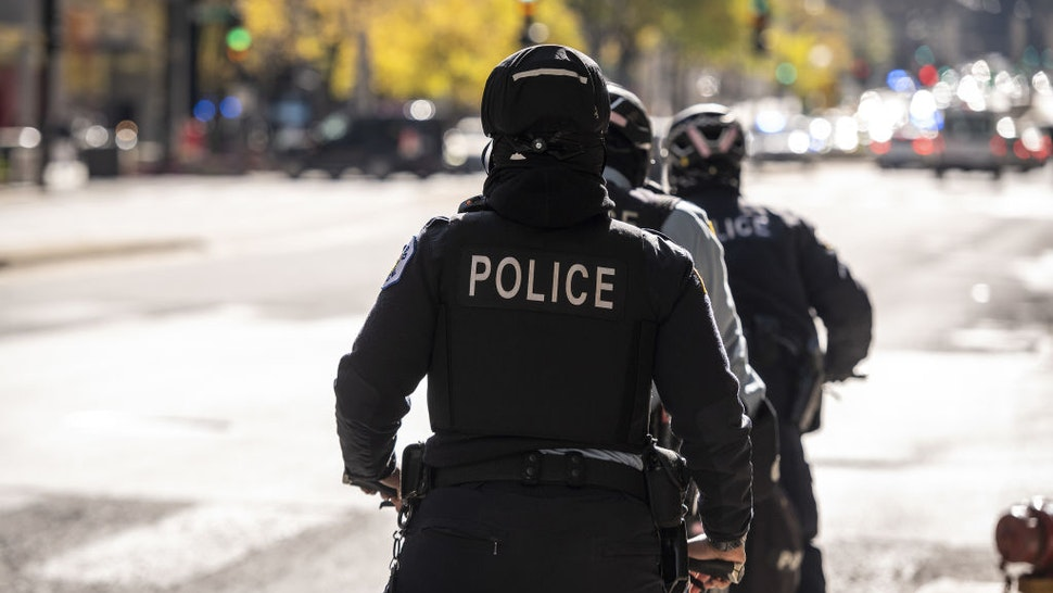 Chicago police officers patrol Michigan Avenue in Chicago, Illinois, U.S., on Nov. 2, 2020. After being caught off guard during nationwide social unrest this summer and suffering millions in damages, retailers have spent months prepping for another possible bout of vandalism on Election Day. Photographer: Christopher Dilts/Bloomberg via Getty Images