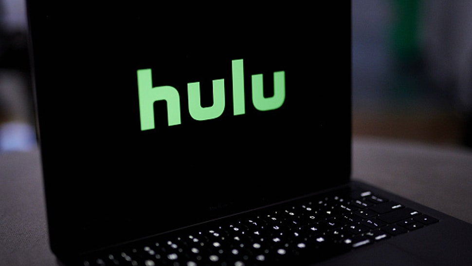 The Hulu logo on a laptop computer arranged in New York, U.S., on Wednesday, Nov. 18, 2020. Walt Disney Co.'s Hulu division is lifting the subscription cost of its live-TV service by 18% to $65 a month, in the latest sign that streaming-video providers are feeling comfortable raising prices for consumers.