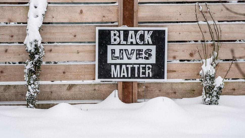 A Black Lives Matter sign sits in the snow outside of a home on February 13, 2021 in Seattle, Washington.