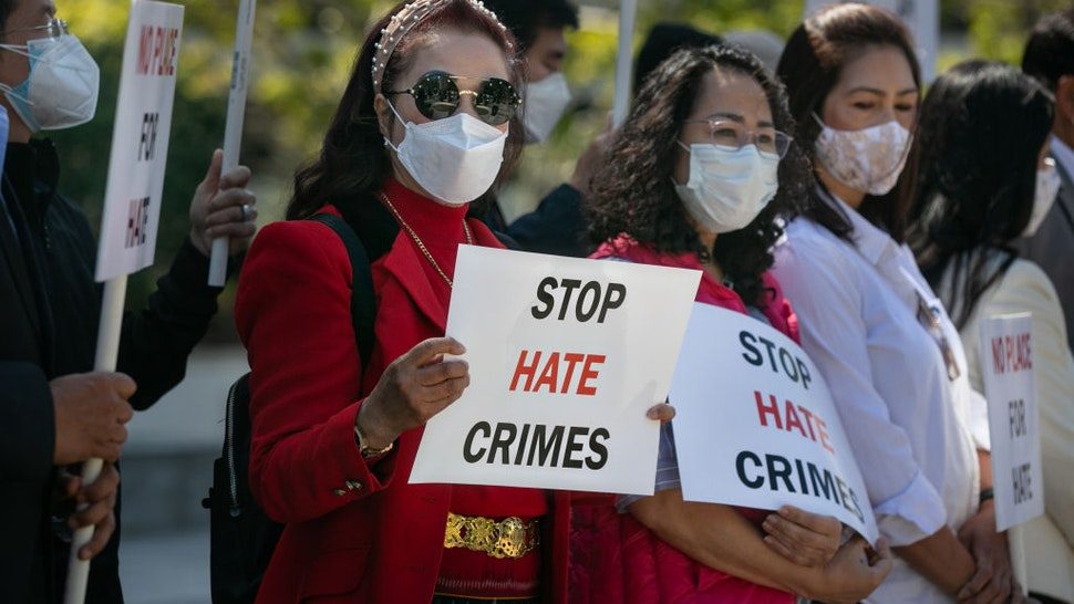 Asian community members hold signs calling for hate to stop at news conference organized to take a unified stand opposing hate crimes against members of the Asian Pacific Islander community on Monday, March 22, 2021 in Los Angeles, CA.