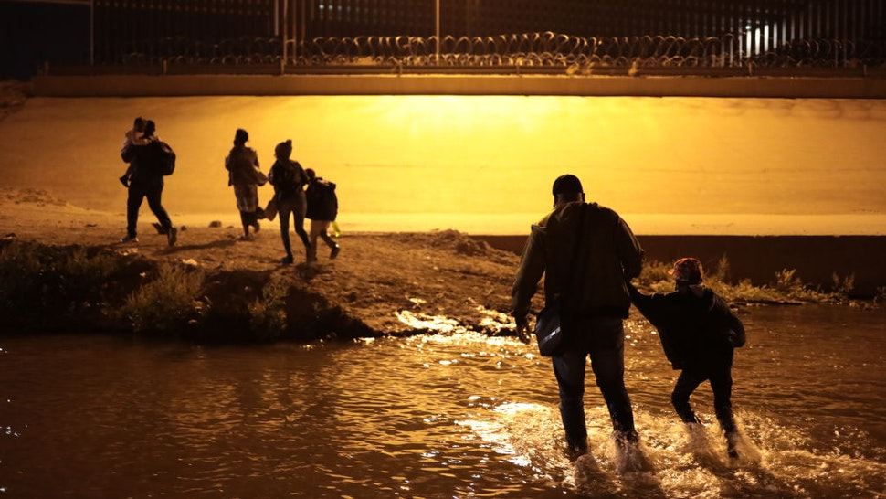 A family from Haiti crosses the Rio Grande, Juarez, Mexico, on March 30, 2021 to surrender to the border patrol to request political asylum in the United States, during the last month an increase in Haitian families has been seen crossing the border city Juarez El Paso Texas (Photo by David Peinado/NurPhoto via Getty Images)