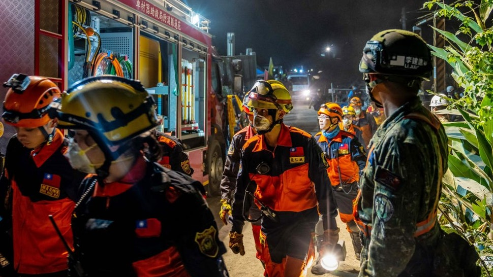 HUALIEN, TAIWAN - APRIL 02: Rescuers work near the site where a train derailed inside a tunnel in the mountains of Hualien, eastern Taiwan on April 2, 2021 in Hualien, Taiwan. Dozens of people are reported to have been killed in the train derailment, the island's worst rail disaster in decades.