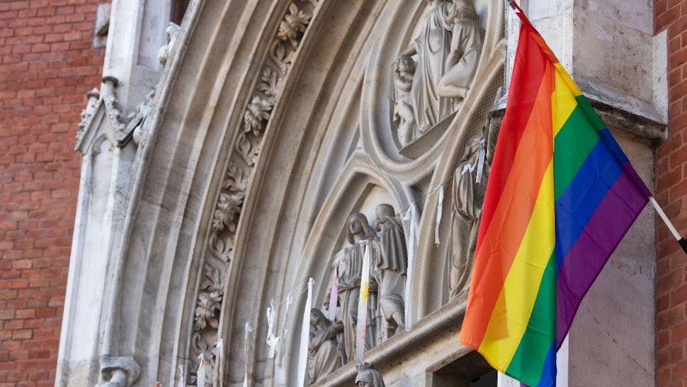 A LGBT rainbow flag hangs outside St Elizabeth Church in Wieden, Vienna, on March 25, 2021.