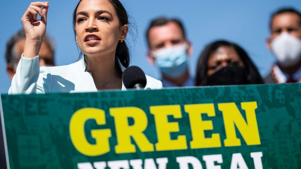 WASHINGTON, DC - APRIL 20: Rep. Alexandria Ocasio-Cortez (D-NY) speaks at a news conference to reintroduce the Green New Deal and introduce the Civilian Climate Corps Act at the Capitol Reflecting Pool near the West Front of the U.S. Capitol Building on Tuesday, April 20, 2021 in Washington, DC.