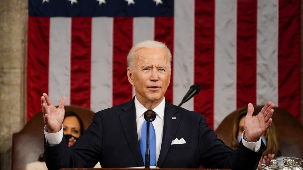 WASHINGTON, DC - APRIL 28: President Joe Biden addresses a joint session of Congress, with Vice President Kamala Harris and House Speaker Nancy Pelosi (D-Calif.) on the dais behind him, on Wednesday, April 28, 2021. Biden spoke to a nation seeking to emerge from twin crises of pandemic and economic slide in his first speech to a joint session of Congress.