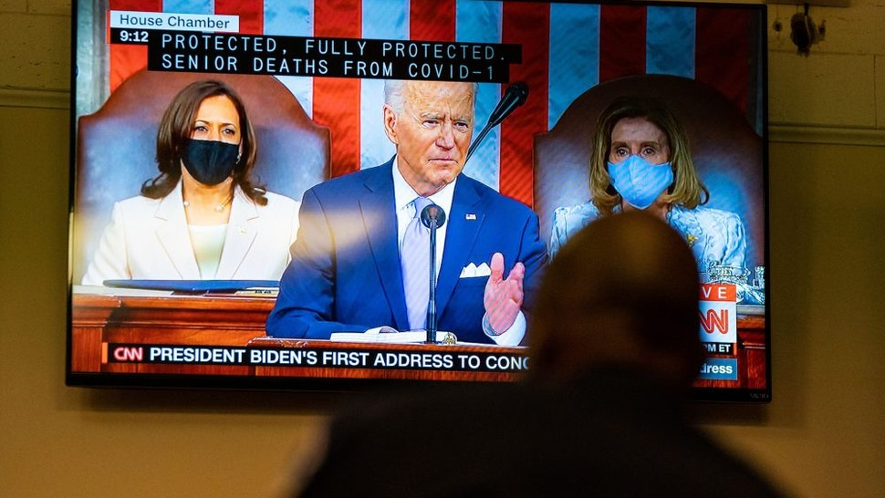 WASHINGTON, DC - APRIL 28: A Capitol Police Officer watches President Joe Bidens address of the Joint Session of the 117th Congress on a television in the Senate Press Gallery, at the U.S. Capitol Building on Wednesday, April 28, 2021 in Washington, DC.
