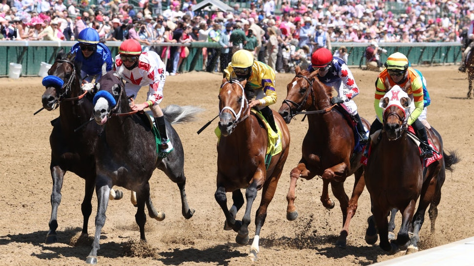 LOUISVILLE, KY - APRIL 30: Mayfield (6) ridden by Jose Ortiz on the far outside in the blue is the winner of the 18th running of The Alysheba during Oaks Day on April 30, 2021 at Churchill Downs in Louisville, Kentucky. (Photo by Brian Spurlock/Icon Sportswire via Getty Images)