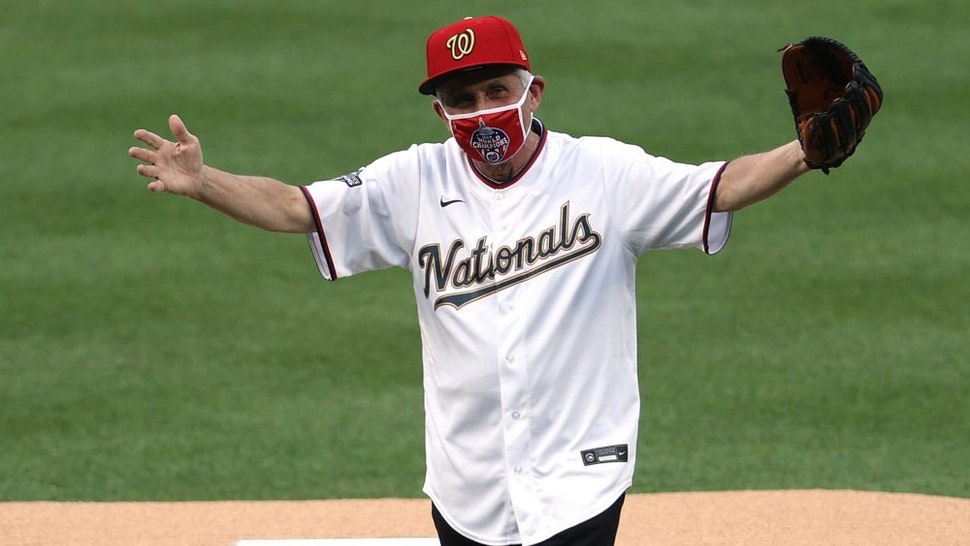 WASHINGTON, DC - JULY 23: Dr. Anthony Fauci, director of the National Institute of Allergy and Infectious Diseases reacts after throwing out the ceremonial first pitch prior to the game between the New York Yankees and the Washington Nationals at Nationals Park on July 23, 2020 in Washington, DC.