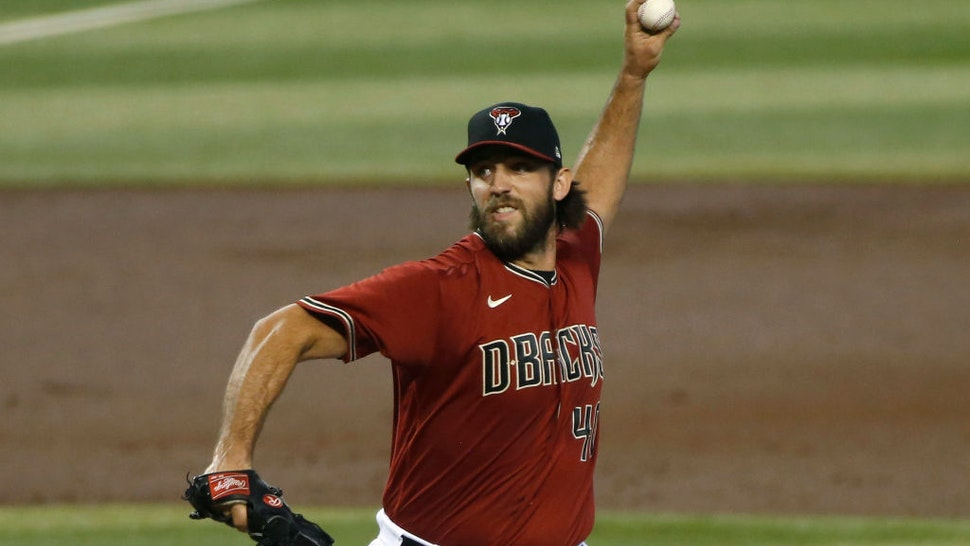 PHOENIX, ARIZONA - SEPTEMBER 27: Starting pitcher Madison Bumgarner #40 of the Arizona Diamondbacks throws a pitch against the Colorado Rockies during the first inning of the MLB game at Chase Field on September 27, 2020 in Phoenix, Arizona. (Photo by Ralph Freso/Getty Images)
