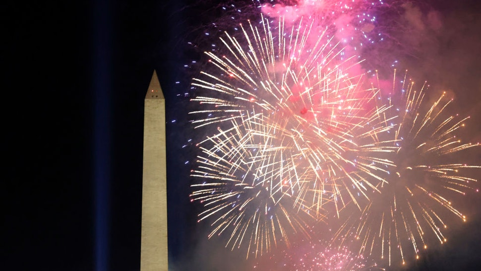 WASHINGTON, DC - JANUARY 20: Fireworks detonate about the Washington Monument during an Inauguration Day event at the Lincoln Memorial on January 20, 2021 in Washington, DC. President Joe Biden and Vice President Kamala Harris were sworn in today. (Photo by Justin Sullivan/Getty Images)