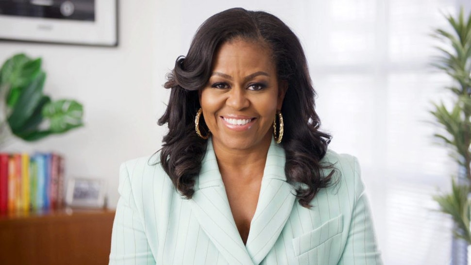 UNSPECIFIED - MARCH 27: In this screengrab, Michelle Obama presents the Social Justice Impact Award during the 52nd NAACP Image Awards on March 27, 2021.