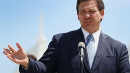 Florida Gov. Ron DeSantis speaks to the media about the cruise industry during a press conference at PortMiami on April 08, 2021 in Miami, Florida.