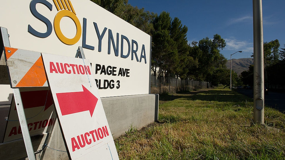 An auction sign stands at the entrance Solyndra LLC building in Fremont, California, U.S., on Wednesday, Nov. 2, 2011.