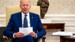 U.S. President Joe Biden meets with members of the Congressional Asian Pacific American Caucus Executive Committee in the Oval Office at the White House on April 15, 2021 in Washington, DC.